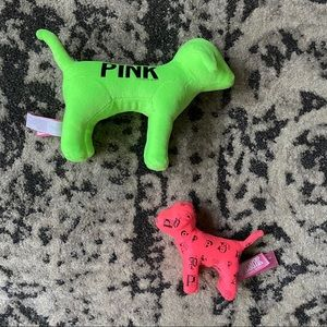 Two Victoria's Secret Pink dogs